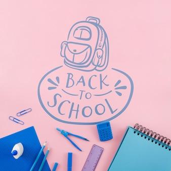 Bovenaanzicht terug naar school met roze achtergrond