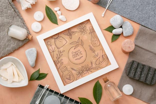 Bovenaanzicht van beauty spa essentials met frame en kaarsen