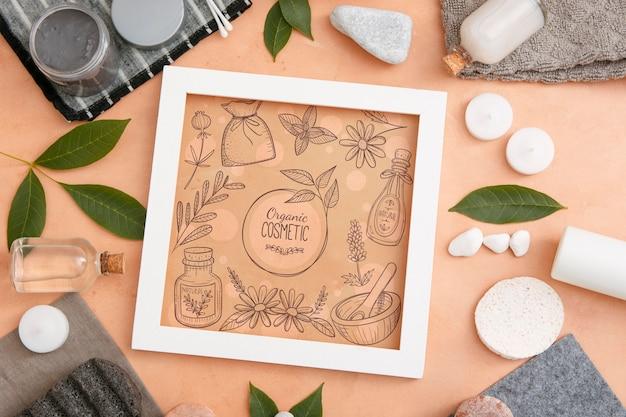 Bovenaanzicht van beauty spa essentials met frame en stenen