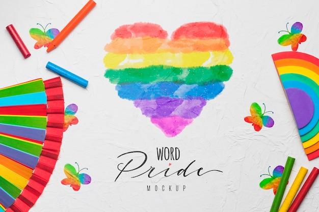 Bovenaanzicht van hart met regenboogkleuren voor trots
