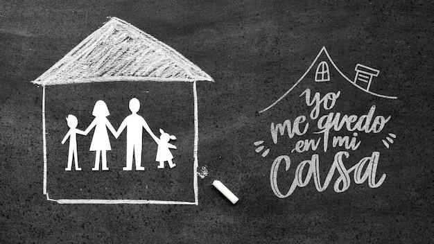 Bovenaanzicht van krijt huis met familie