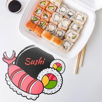 Bovenaanzicht van sushi op tafel met sojasaus