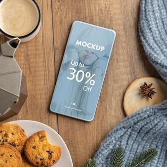 Bovenaanzicht winterhygge-arrangement met telefoonmodel