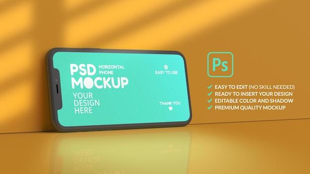 Breedbeeld smartphone mockup op een gele achtergrond in 3d-rendering
