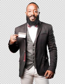 Bussines zwarte man toont zijn creditcard