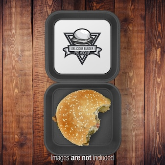 Caja negra burger abierta con media burger