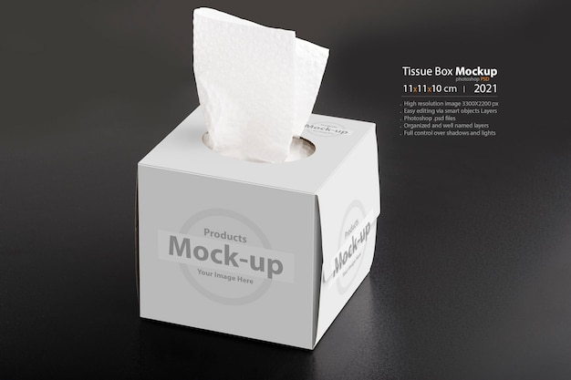 Caja de pañuelos cúbicos sobre fondo negro, serie de maquetas psd editables con plantilla de capas de objetos inteligentes lista para su diseño