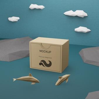 Caja de papel del día del océano con concepto de delfines