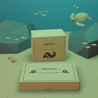 Cajas de cartón y vida marina con concepto de maqueta