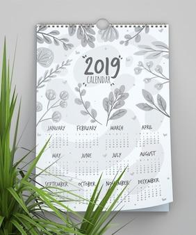 Calendario con modello di sfondo di foglie