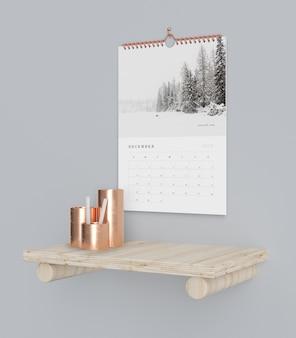Calendario en maqueta de concepto de libro gancho