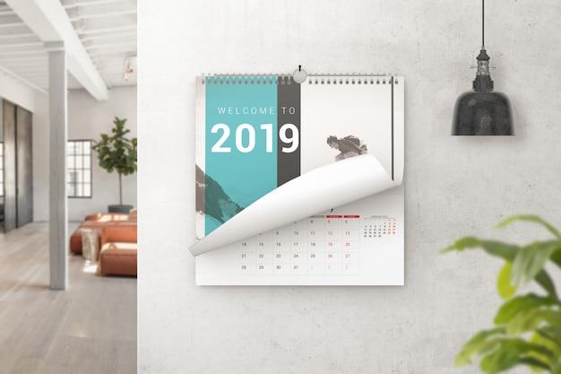 Calendario de pared pasando página maqueta
