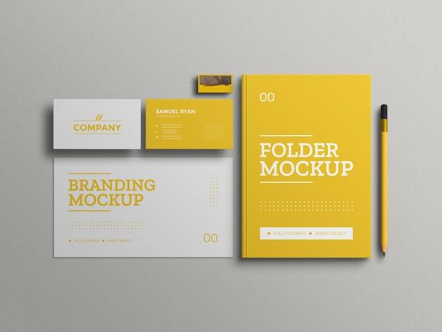 Carpeta amarilla mínima con maqueta de conjunto de papelería de tarjeta de visita