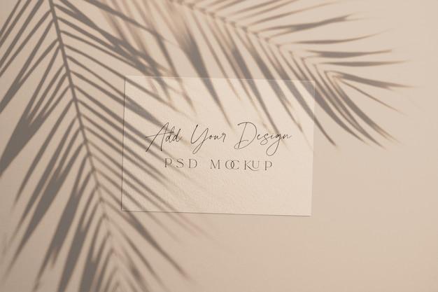 Carta con foglie di palma ombra sovrapposta