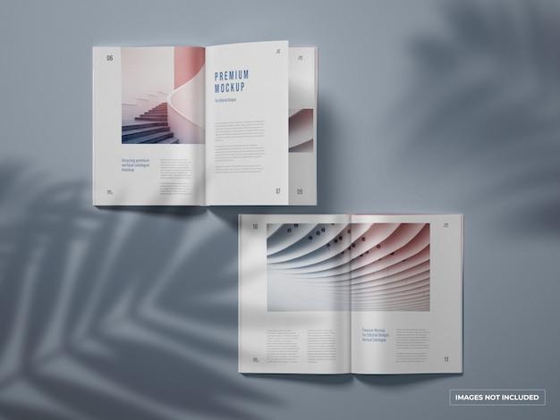 Catálogo vertical abierto y maqueta de revista