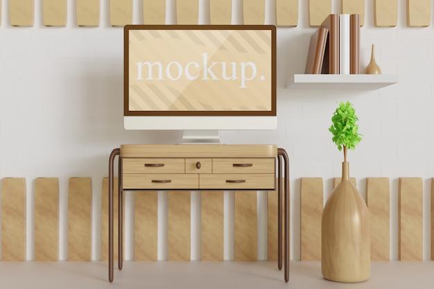 De cerca en la maqueta del monitor en la mesa de madera, vista frontal con jarrón de plantas