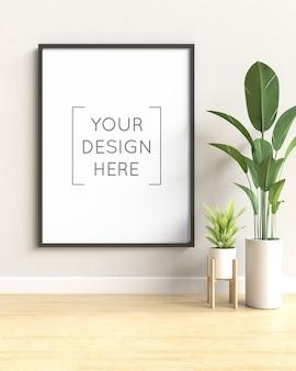 Cerrar en maqueta de marco de fotos con planta