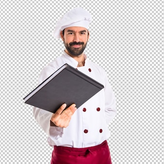 Chef-kok die een boek geeft