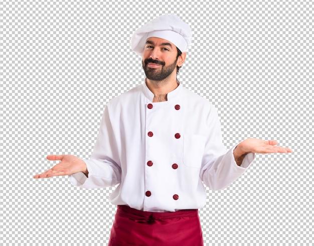 Chef-kok die twijfels over witte achtergrond heeft