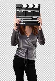 Chica joven hermosa que sostiene un clapperboard