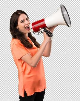 Chica joven hermosa que sostiene un megáfono