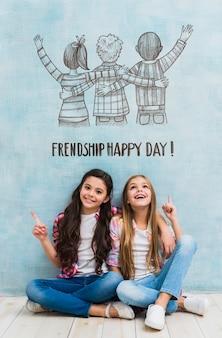 Chicas en maqueta del día de la amistad.