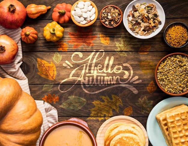 Ciao citazione d'autunno circondata da deliziosi cibi autunnali