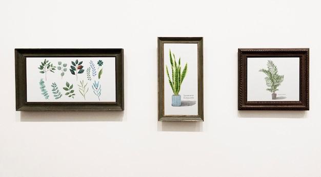 Colección de piezas de arte de hoja en una pared.