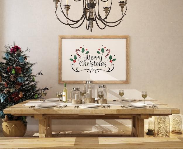 Comedor navideño con marco de póster de maqueta y árbol de navidad
