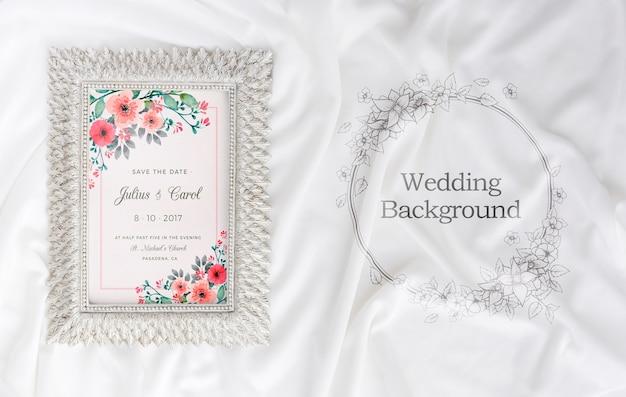 Composición de elementos de boda con maqueta de marco