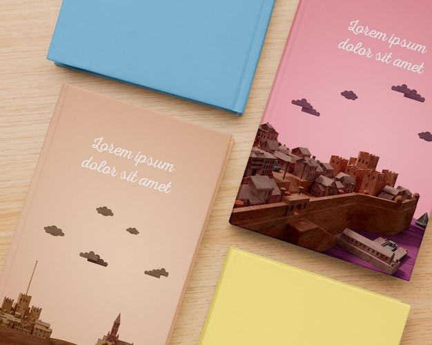 Composición de maqueta plana cubierta de libros minimalistas
