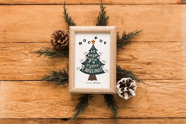 Composición de navidad de vista superior con mockup de marco