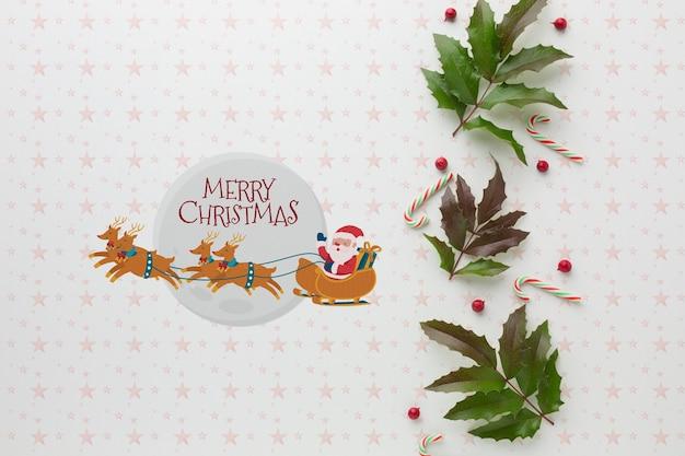 Composición navideña con hojas verdes vista superior
