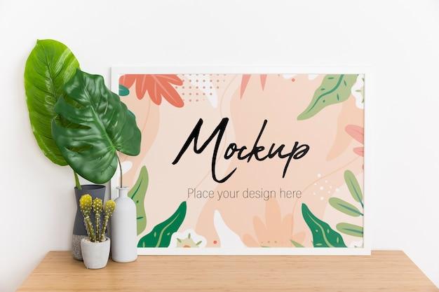 Composizione interna con cornice e pianta mock-up