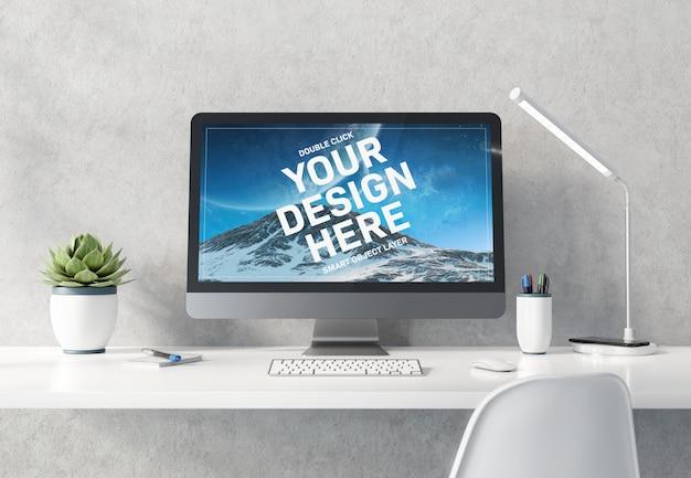 Computadora en maqueta interior de escritorio de hormigón blanco