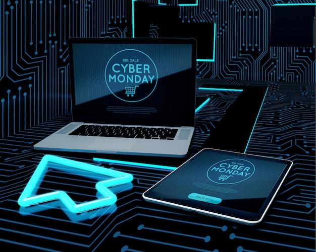 Computadora portátil y tableta junto al clic de neón