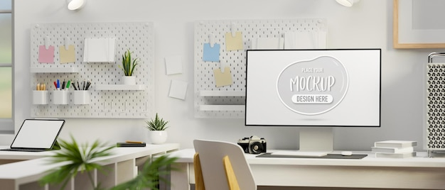 Computer met mockup-scherm op de werktafel in witte concept kantoorruimte 3d-rendering