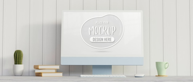 Computerapparaat met mockup-scherm op het bureau met boekencactuspot en mok