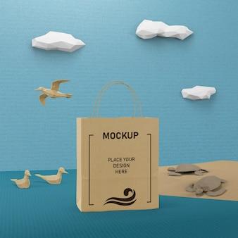 Concepto de bolsa de papel y vida marina con maqueta