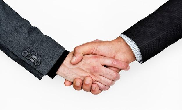 Concepto corporativo del negocio del apretón de manos de las manos humanas