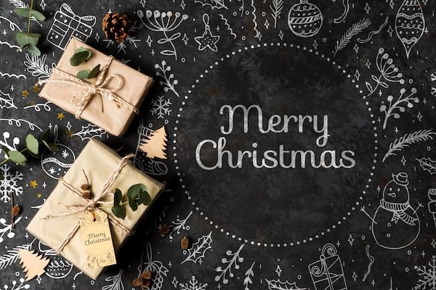 Concepto de feliz navidad con regalos en la mesa
