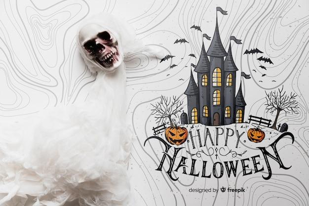 Concepto de halloween con calavera y casa embrujada