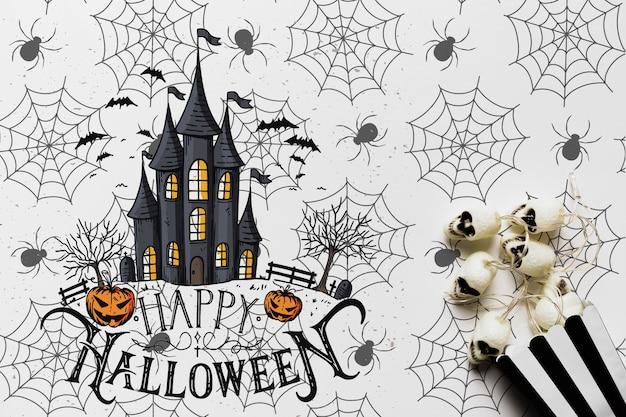 Concepto de halloween con casa embrujada y calaveras