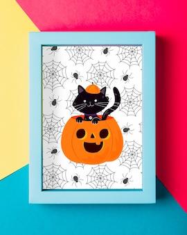 Concepto de marco de halloween con gato negro y calabaza