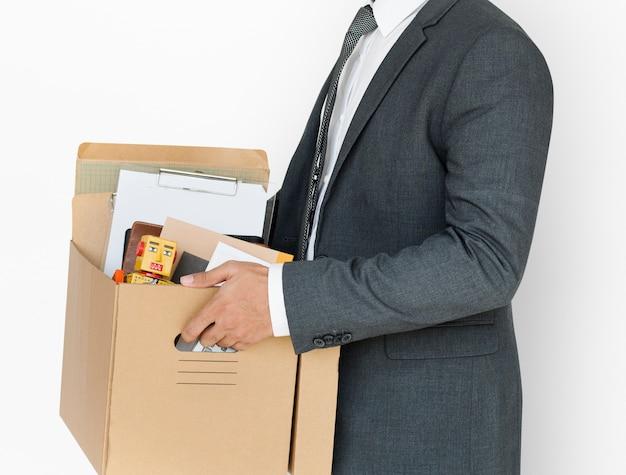 Concetto della scatola della tenuta dell'uomo di affari