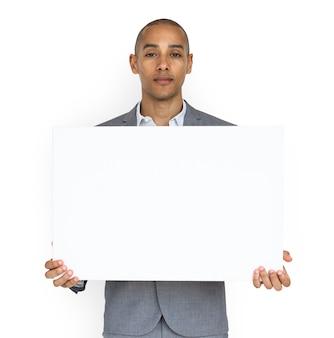 Concetto dello spazio della copia di holding placard dell'uomo d'affari