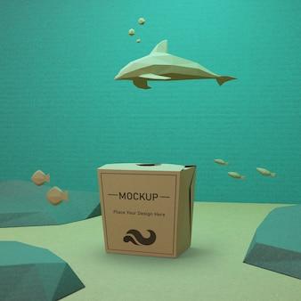 Concetto di giorno dell'oceano con sacco di carta e delfino