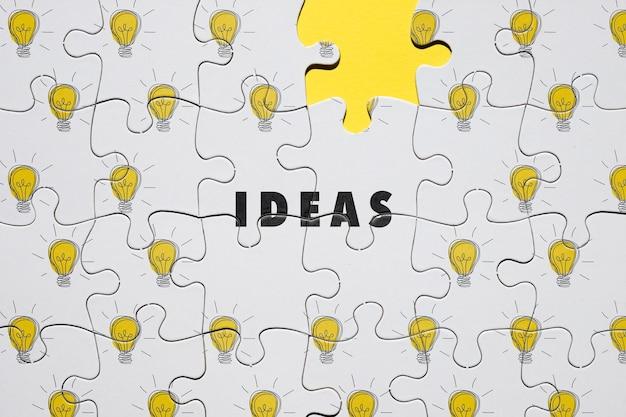 Concetto di puzzle con lampadine