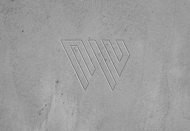 Concrete muur textuur ingeslagen logo mockup