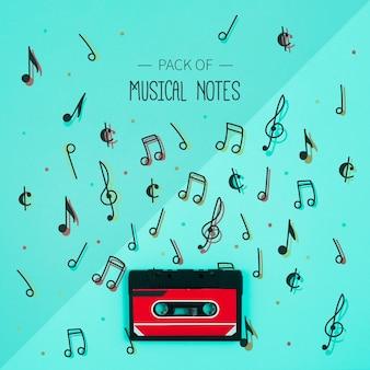 Conjunto de colección de notas musicales con cinta al lado